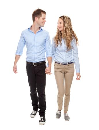 people walking white background: Young romantic couple walking, isolated on white Stock Photo