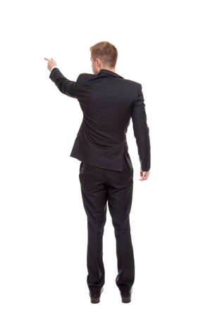 pointing finger: Back view of a business man pointing finger