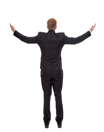 man behind: Back view of a businessman presenting your ad Stock Photo