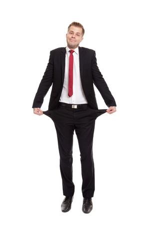 empty pockets: Broke businessman with empty pockets on white