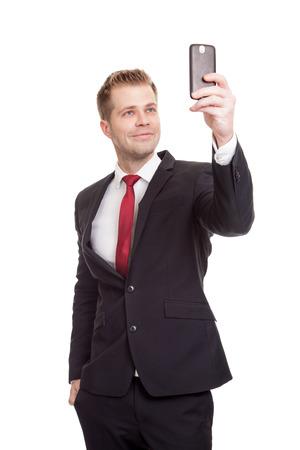 Knappe zakenman die een selfie met een mobiele telefoon Stockfoto