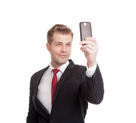 휴대 전화와 함께 selfie을 가지고 잘 생긴 사업가 스톡 콘텐츠