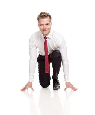 Businessman in starting position ready for chasing deals