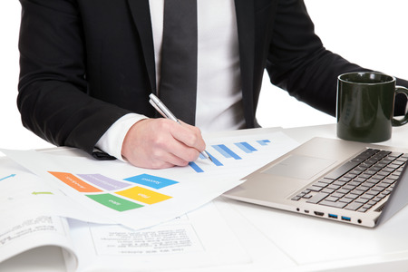 Businessman analysing data in the office photo