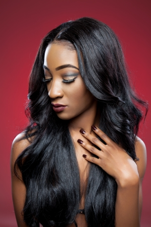 long silky hair: Young black beautiful woman with elegant curly hair