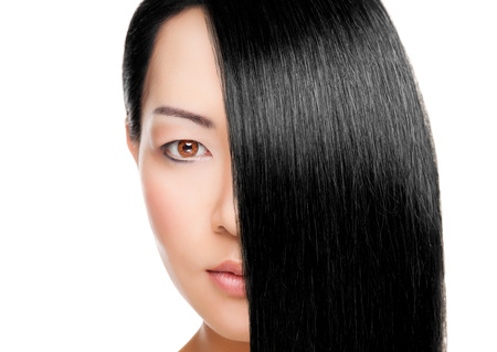 shiny black: Beautiful young Thai woman with long elegant straight hair Stock Photo