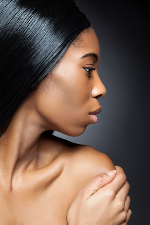 Young black beauty with perfect skin photo