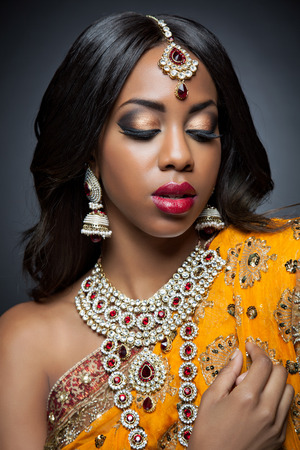 costume jewelry: Young Indian woman dressed in traditional clothing with bridal makeup and jewelry