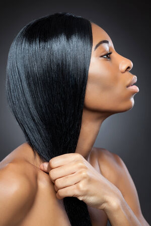 Young black beauty with long straight hair photo
