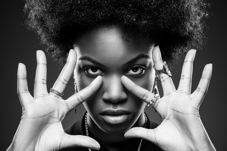 natural make up: Young black woman with afro hair style Stock Photo