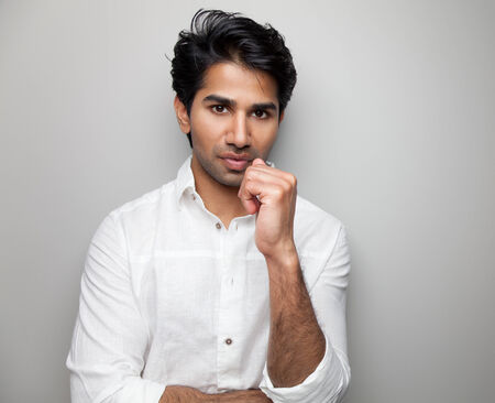 Portrait of a handsome Indian man wearing white photo