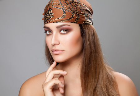 Young caucasian beauty wearing a headscarf