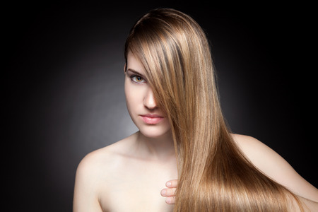 Young beauty with long, elagant and shiny hair photo