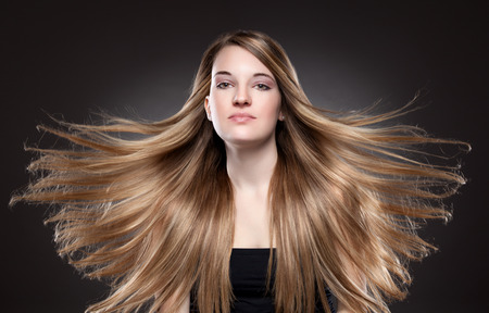 silky hair: Young beauty with long, elagant and shiny hair