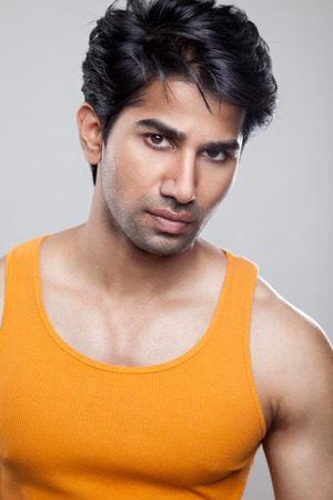 Handsome Indian man wearing a tank top photo