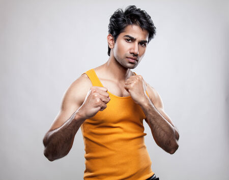 Handsome Indian man prepared to fight photo
