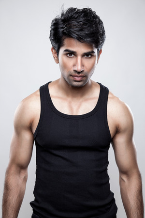 tank top: Handsome Indian man wearing a tank top