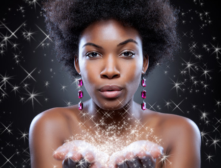 Beautiful young black woman making magic happen Reklamní fotografie