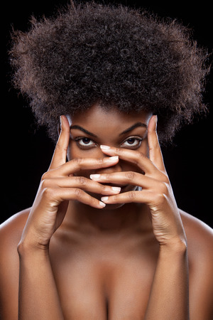 african american woman hair: Young African beauty covering face with hands