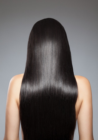 head back: Back view of a woman with long straight hair
