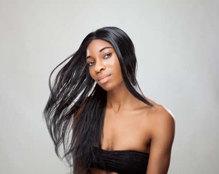 Beautiful young black woman with long straight hair photo