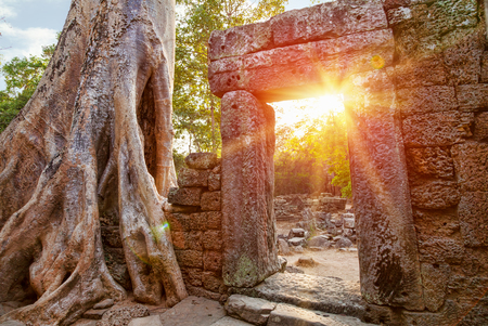 Ruins of Cambodian temple at sunset photo