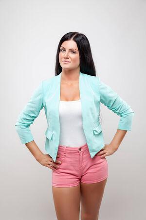 hot legs: Beautiful young woman wearing a fashionable jackett and pink shorts