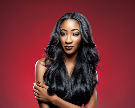 Black beautiful woman with long luxurious shiny hair Stok Fotoğraf