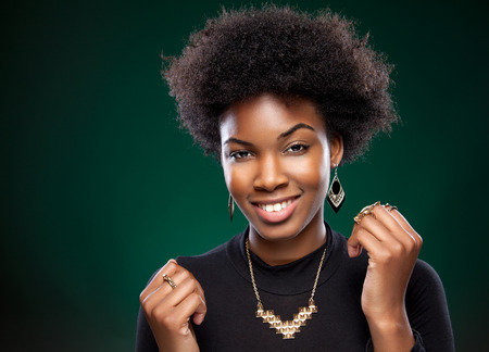 Beautiful young black woman with afro hairstyle photo