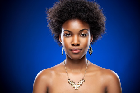 natural woman: Beautiful young black woman with afro hairstyle