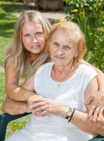 Providing help and care for elderly people photo