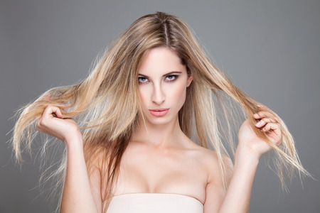 messy hair: Beautiful woman with long and straight messy hair