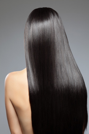 back straight: Woman with long straight shiny luxurious hair