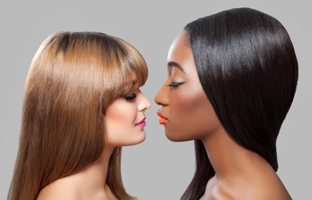 Black and Caucasian beauties with perfect skin and straight hair photo