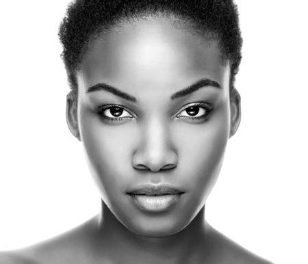 black women hair: Face of an young black beauty in black and white Stock Photo