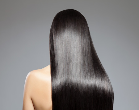 black hair: Back view of a woman with long straight hair