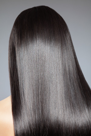 shiny black: Back view of a woman with long straight hair