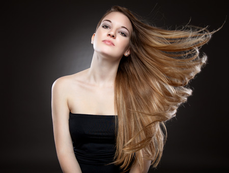 Beautiful woman with strong long brown hair Stok Fotoğraf