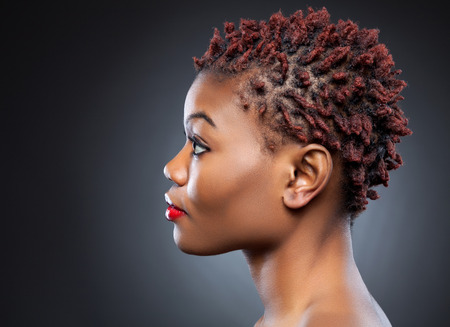 women hair: Black beauty with short spiky red hair Stock Photo