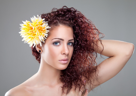 redhaired: Beautiful young woman with red curly hair Stock Photo