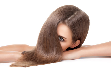 haircare: Beautiful young brunette with long straight hair
