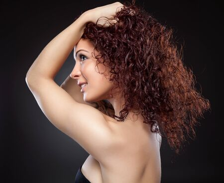 Beautiful young woman with red curly hair Stock Photo