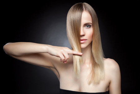 blond hair: Beautiful young lady with straight hair Stock Photo