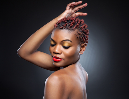 spiky: Black beauty with short spiky red hair Stock Photo