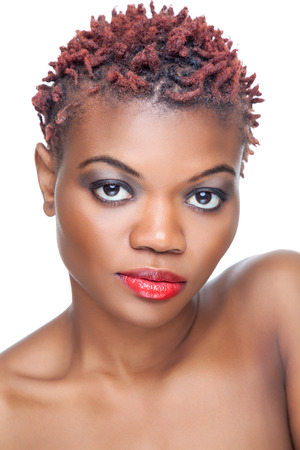 ebony: Black beauty with short spiky red hair Stock Photo