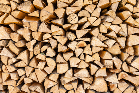 stacked up: Background of chopped firewood stacked up on top of each other in a pile
