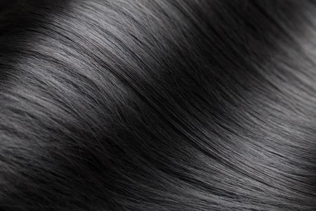 豪華なストレートと光沢のある黒い髪にクローズ アップ