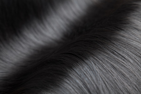 black women hair: Closeup on luxurious straight and glossy black hair Stock Photo