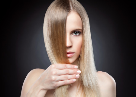 color hair: Profile of a beauty with long blonde straight hair