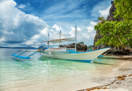 nido: Traditional boat used for island hopping in El Nido, Philippines